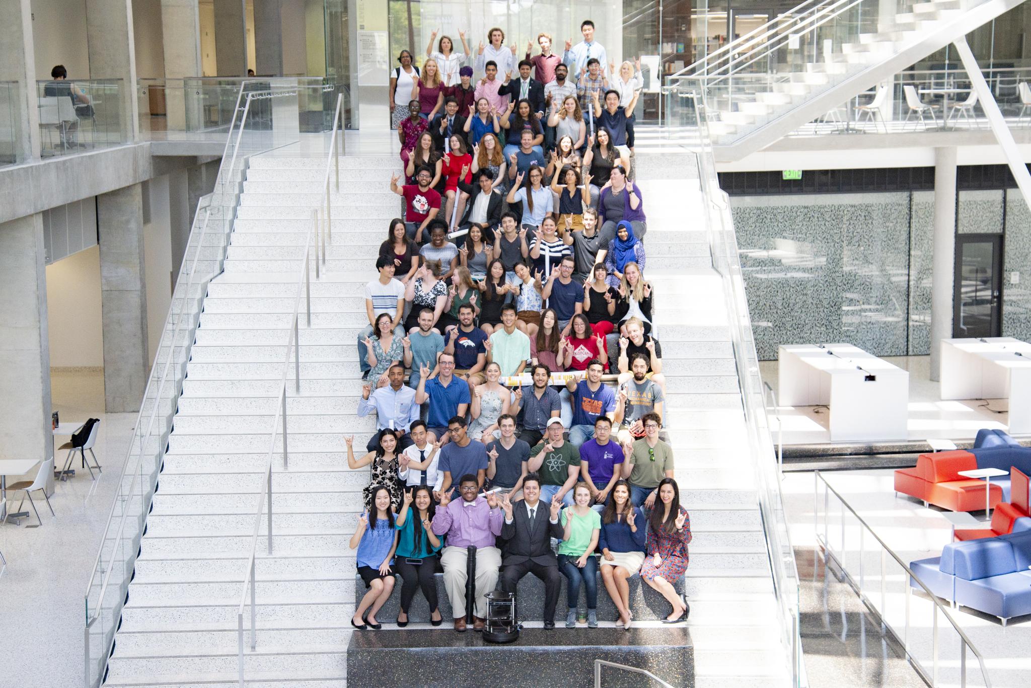 Past REU and RET participants pose in the ECE atrium.
