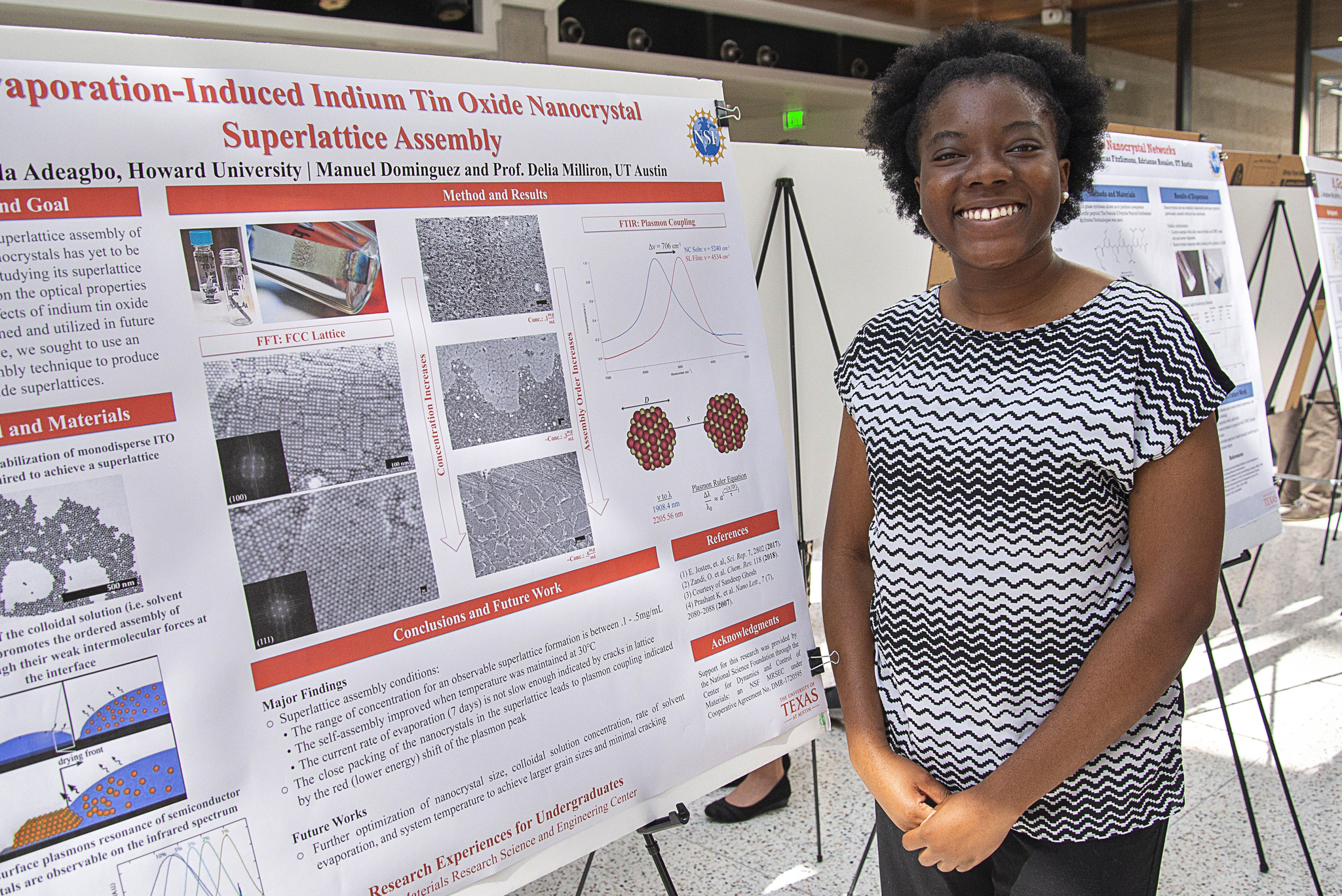 Adebola Adeagbo, past REU student, stands before her research poster during the end of summer poster symposium.