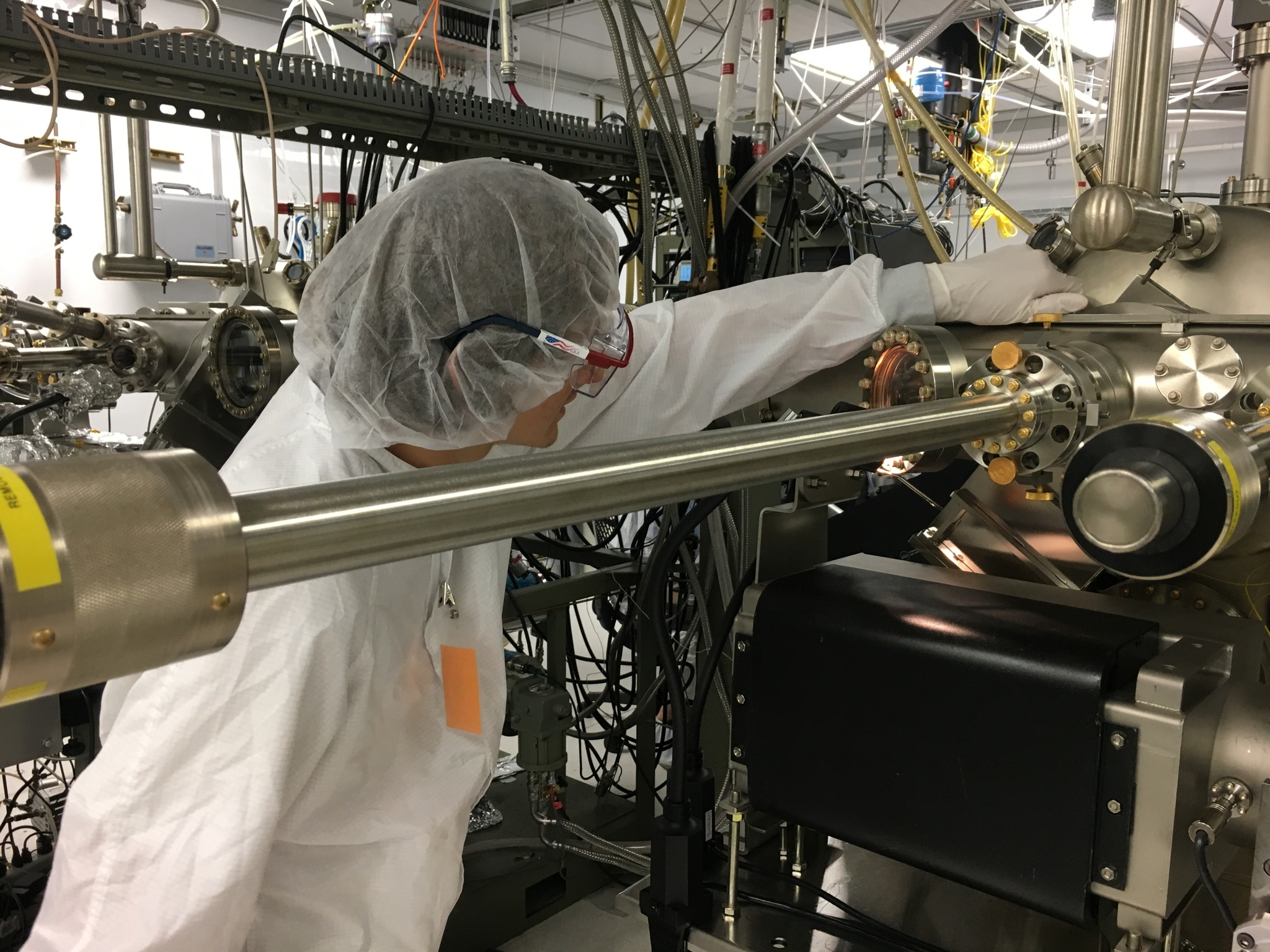 Andrew MacArthur, a past REU student, conducts research in a clean room.